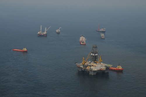 Crews work to collect oil on May 8 around the spot where BP's Deepwater Horizon oil platform caught fire and sank. Photograph U.S. Coast Guard, Petty Officer 3rd Class Casey J. Ranel.