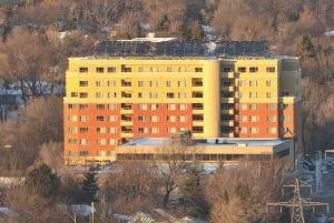 An array of 60 solar thermal panels is mounted on the roof of the West Village residence in Hamilton, Ontario. Its peak output is 105 kilowatts.