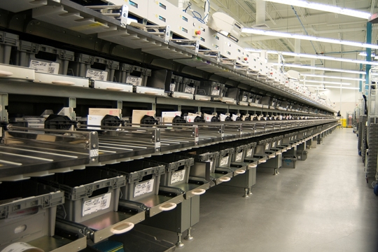 """Sorting machines at the new Canada Post processing plant in Winnipeg. The machine is called a """"Multi Line Optical Character Reader."""""""