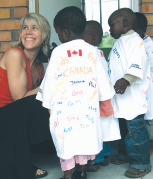 Lea Chambers with children at one of the Golder Trust projects in Africa.