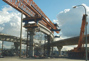 Launcher erecting precast segments of the elevated guideway at Bridgeport Station.
