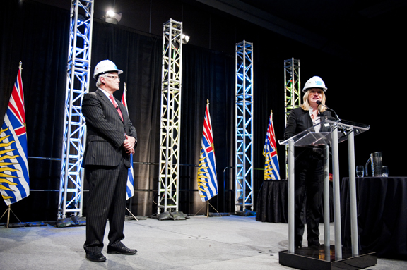 Premier Campbell and Glenn Martin of CEBC at the podium.