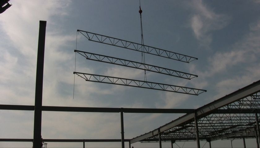 Installing tree joists in order. Photo courtesy Canam.