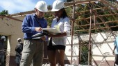 Shane Copp of Read Jones Christoffersen (left) talking to the contractor's architect at St. Joseph School in  Embouchure, Haiti. The site has no roads or electricity and is a two hour hike from the nearest road.