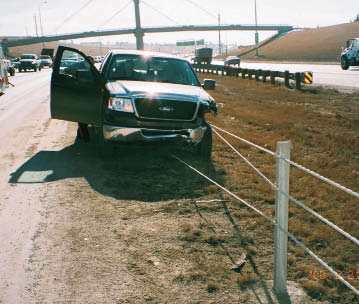 Pick-up truck stopped by a high tension median cable barrier on Deerfoot Trail.