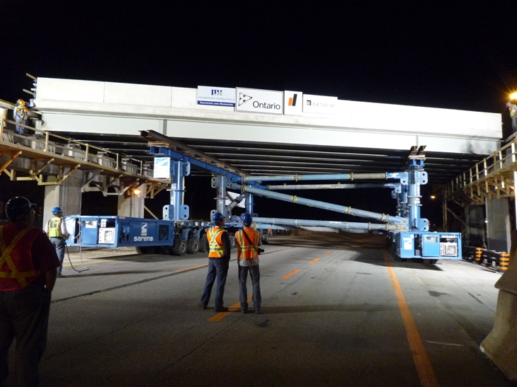 A span being moved into position during the rapid replacement of the Aberdeen Avenue Bridge over Highway 403 in Hamilton, Ontario last July.