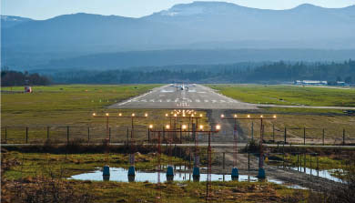 Runway with high intensity lighting, bright even in daylight.  Image from Associated Engineering.