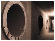 "Ventilation ""earth tubes"" emerge in a huge plenum in the basement."