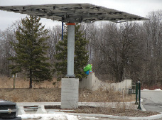 One of six photovoltaic arrays added recently in the parking lot.