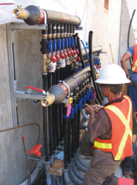 Geo-exchange manifold being installed, North Vancouver Library, Auust 2007.  Photo by Geoff McDonnell, P.Eng.