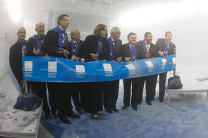 Politicians and university officials in the wind tunnel at the official opening of the UIOT General Motors of Canada Automotive Centre of Excellence. Federal Minister of Finance Jim Flaherty is third from the right.