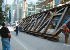 Installing giant steel trusses for the Ritz-Carlton Hotel in Toronto.