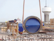 1500-mm butterfly valve being placed in the new access house.