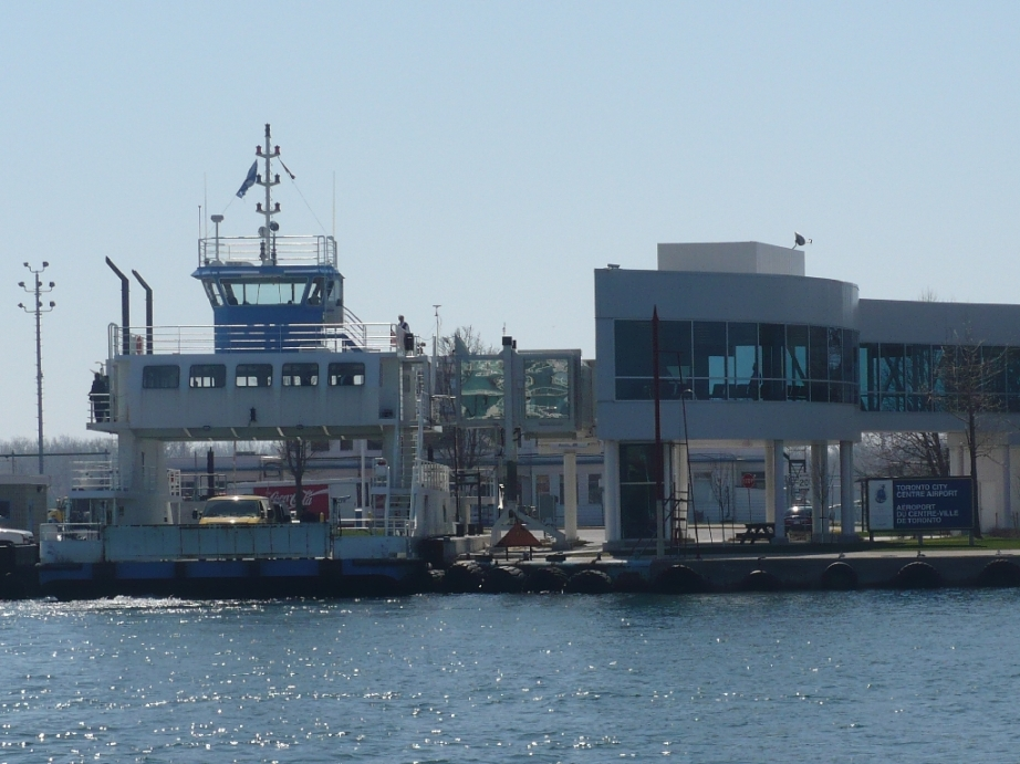 Ferry to the Toronto Island. The ferry ride is less than two minutes, but sometimes passengers have to line up for much longer to get on the crowded decks.   Photo Secondarywaltz, Wikimedia Commons.