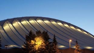Uplights shine through the new roof, creating drama at night.
