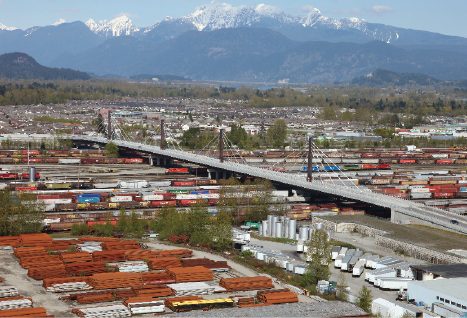 The impressive structure - a hybrid twin box-girder and cable-stayed design - crosses multiple railway lines.