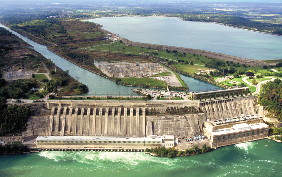 The Sir Adam Beck Generating Station near Niagara Falls, Ontario has a pumped power facility dating from 1957. It is visible in the photo to the left of the reservoir, behind the concrete penstocks in the foreground. Image courtesy Ontario Power Generation.