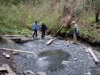Freda Leong (centre) checking out a geothermal water source on Gitwinksihlkw lands in B.C.