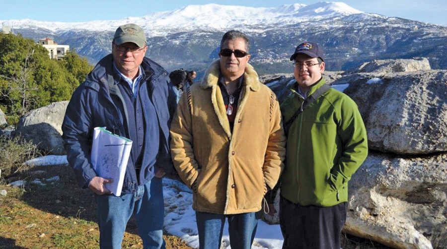Ryan Williams (at right) on site with two members of the design team. Mount Lebanon is visible in the background.