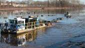 Dredging in process; the lake was divided into 16 dr3ede zones, partly to contain turbidity.