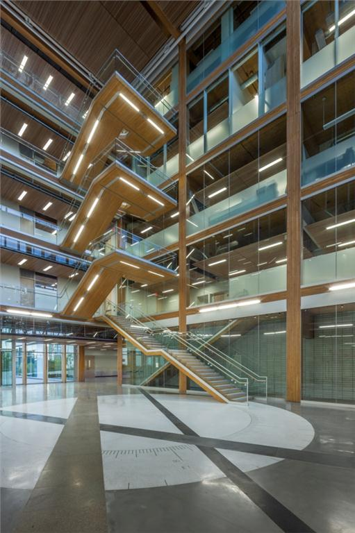 Free-floating glulam staircase in the atrium at the Earth Sciences Building, University of British Columbia. Photograph courtesy Perkins + Will Architects.   Photographer Michael Elkan.