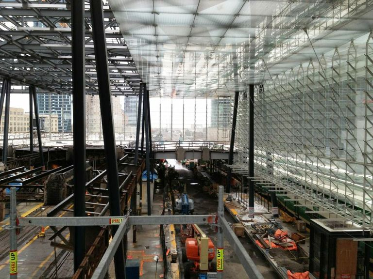 """Construction photograph of the """"glass jewel box"""" being inserted in the train shed roof at Union Station in Toronto. Photograph courtesy Zeidler Partnership Architects."""