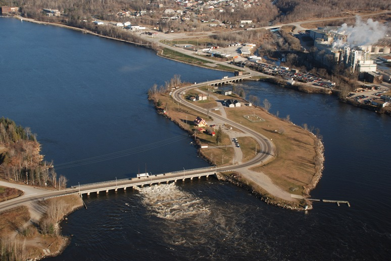 photo  Aerial view of Timiskaming Dam Complex on the Ottawa River, on the border between Quebec and Ontario, 65 miles northeast of North Bay. The Ontario Dam is in the foreground and the Quebec Dam is on the far side of the island. Photo courtesy PWGSC.