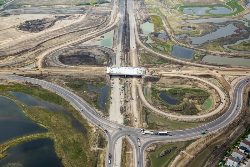 An intersection on the Southeast Stoney Trail. Image from  http://www.sestproject.ca/photo-gallery