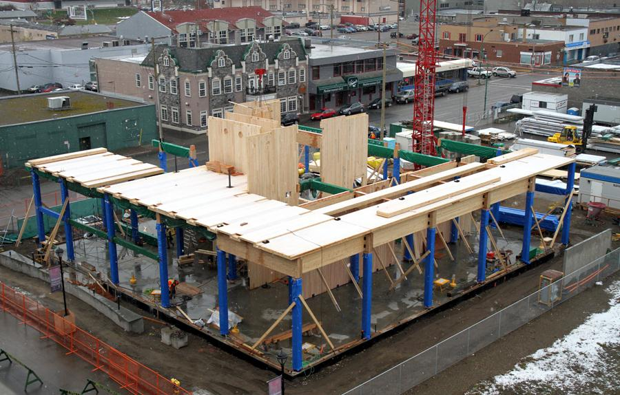 Wood Innovation and Design Centre under construction in downtown Prince George, B.C. The photograph shows the building under construction, with the double-height main floor and core shaft. Photo courtesy WoodWORKS! BC.