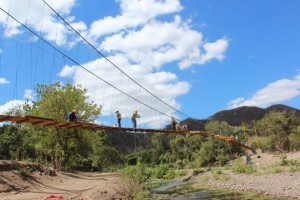 Engineers from Buckland and Taylor, along with other volunteers, complete work on a pedestrian suspension bridge for the Rio Abajo community in rural Nicaragua.