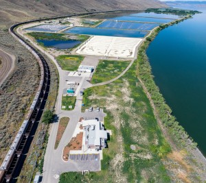 Aerial view of completed Wastewater Treatment Plant in Kamloops, B.C. beside the Thompson River. The modified lagoons are in the upper left (BNR modification) and middle (membrane modification). Photo: Urban Systems.