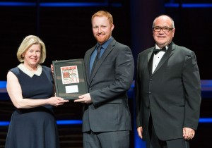 Mark Byram, P.Eng.  (centre) of Levelton receiving the Young Professional Award at the ACEC-BC awards in Vancouver on April 10. Photo: ACEC-BC/Kim Stallknecht. At right is Keith Sashaw, president and CEO of ACEC-BC.