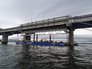 Work under way on the superbeam and modular truss installed in an emergency on Montreal's Champlain Bridge.  Buckland and Taylor were the design and construction engineers for the remediation. Photo courtesy:  Buckland & Taylor.