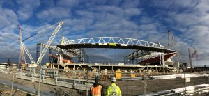 Lifting a roof canopy structure into place at BMO Field, Toronto on February 21, 2016.   Photo courtesy PCL.
