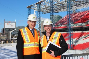 PCL Toronto vice president and district manager Bruce Sonnenberg and senior project manager Neil Barrows at the BMO Field site, a few days before the south canopy was installed. Image: PCL.