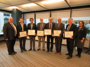 Infrastructure Resilience Professionals receiving their certificates from Kim Allen (at left) from Engineers Canada. Photo:  Engineers Canada.