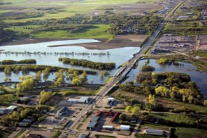 Aerial view of Assiniboine River in Brandon, Manitoba during the 2011 flood. Photo: Manitoba Infrastructure and Transportation.