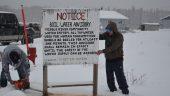Removing boil water advisory sign