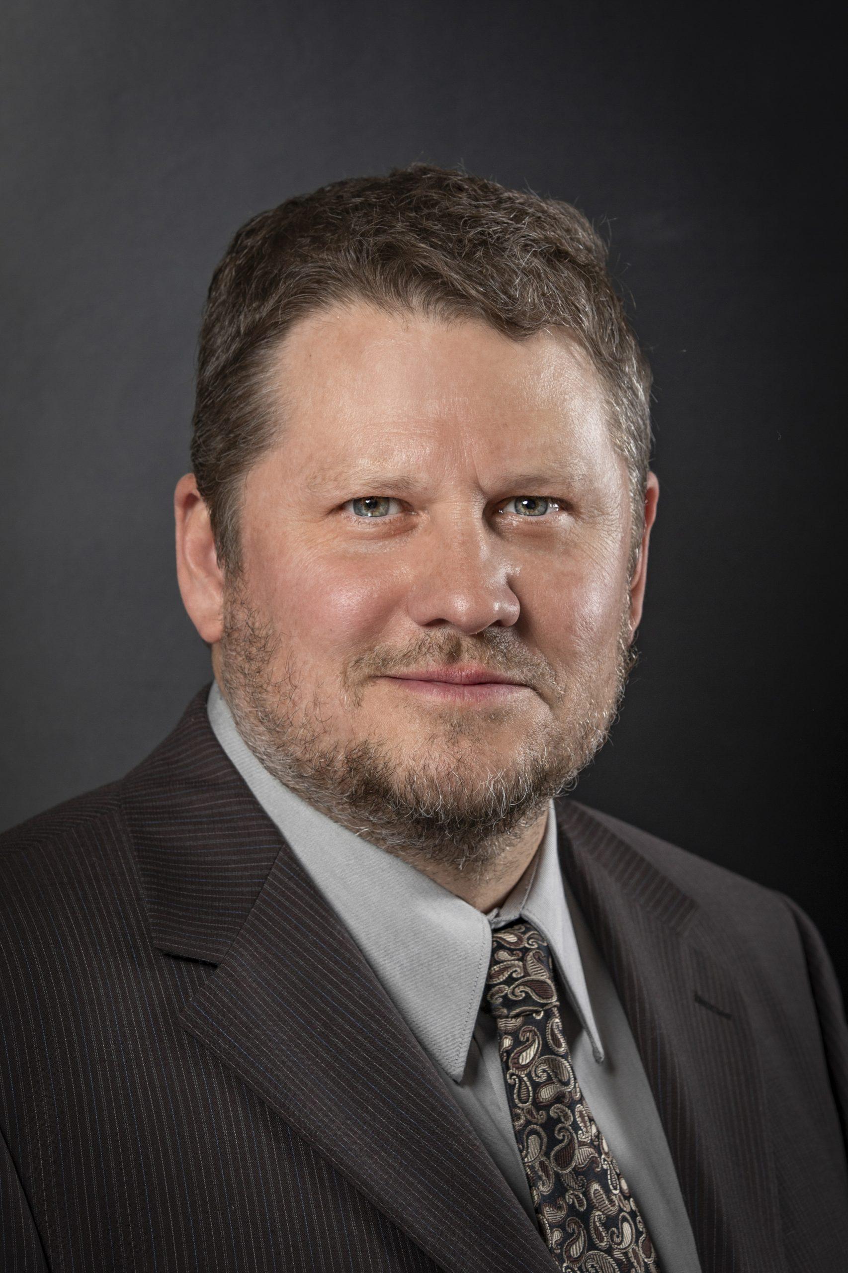 Ken J Huber